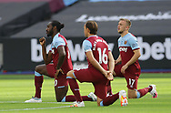 Michail Antonio of West Ham United takes a knee with his playing colleagues during the Premier League match at the London Stadium, London. Picture date: 20th June 2020. Picture credit should read: David Klein/Sportimage
