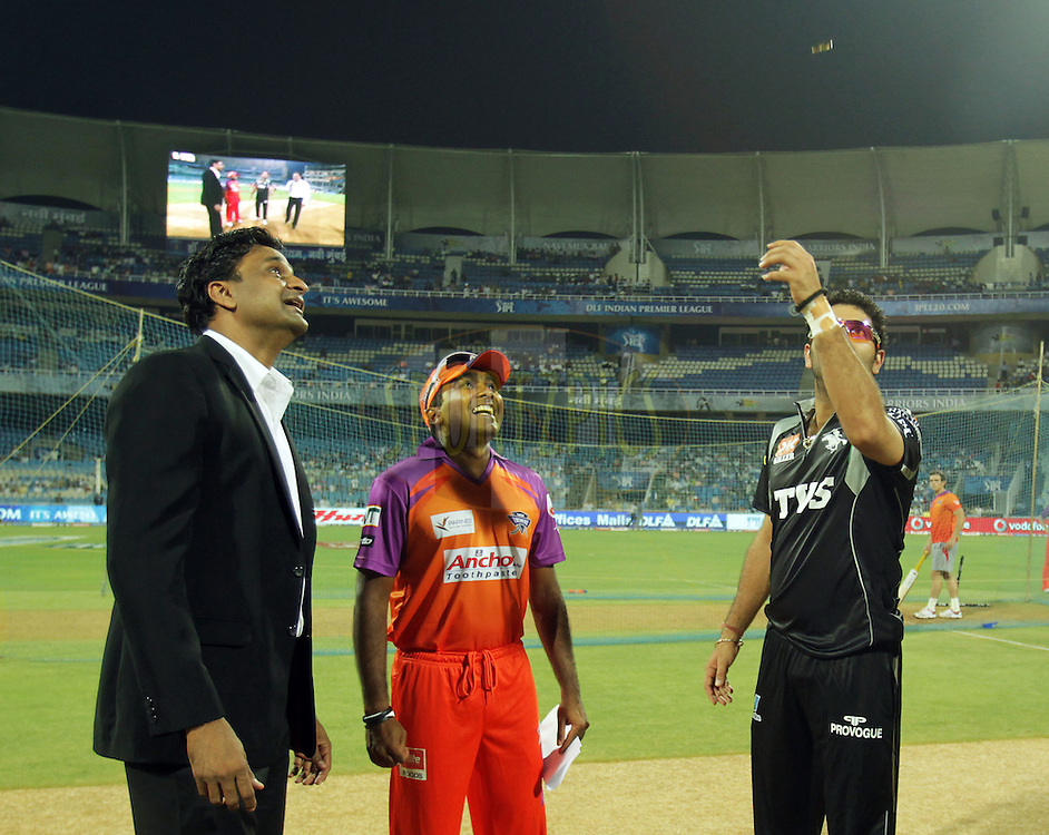 Pune Warriors captain Yuvraj Singh tosses the coin as Mahela Jayawardene captain of Kochi Tuskers Kerala watches during  match 10 of the Indian Premier League ( IPL ) Season 4 between the Pune Warriors and the Kochi Tuskers Kerala held at the Dr DY Patil Sports Academy, Mumbai India on the 13th April 2011..Photo by BCCI/SPORTZPICS