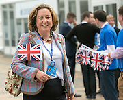 © Licensed to London News Pictures. 28/09/2014. Birmingham, UK. A woman waves a Union Flag as she arrives at conference. Delegates outside ethe conference centre.  The Conservative Party Conference in Birmingham 28th September 2014. Photo credit : Stephen Simpson/LNP