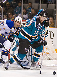 January 6, 2010; San Jose, CA, USA; San Jose Sharks center Torrey Mitchell (17) steals the puck from St. Louis Blues center Alexander Steen (20) during the first period at HP Pavilion. MSan Jose defeated St. Louis 2-1 in overtime. Mandatory Credit: Jason O. Watson / US PRESSWIRE