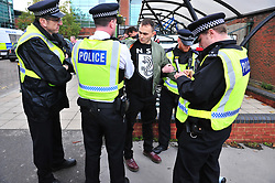 © Licensed to London News Pictures.04/11/2017.<br /> BROMLEY, UK.<br /> Anti fascist protester grabbed by police.<br /> Britain First hold a Persecuted Patriots Rally outside Bromley Police Station, Bromley South.Party Leader Paul Golding and his deputy Jayda Fransen have to sign on bail every Saturday 2pm at Bromley Police station.<br /> Photo credit: Grant Falvey/LNP
