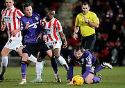 Cheltenham's Omari Sterling-James battles with Morecambe's James Devitt during the Sky Bet League 2 match between Cheltenham Town and Morecambe at Whaddon Road, Cheltenham, England on 16 January 2015. Photo by Alan Franklin.