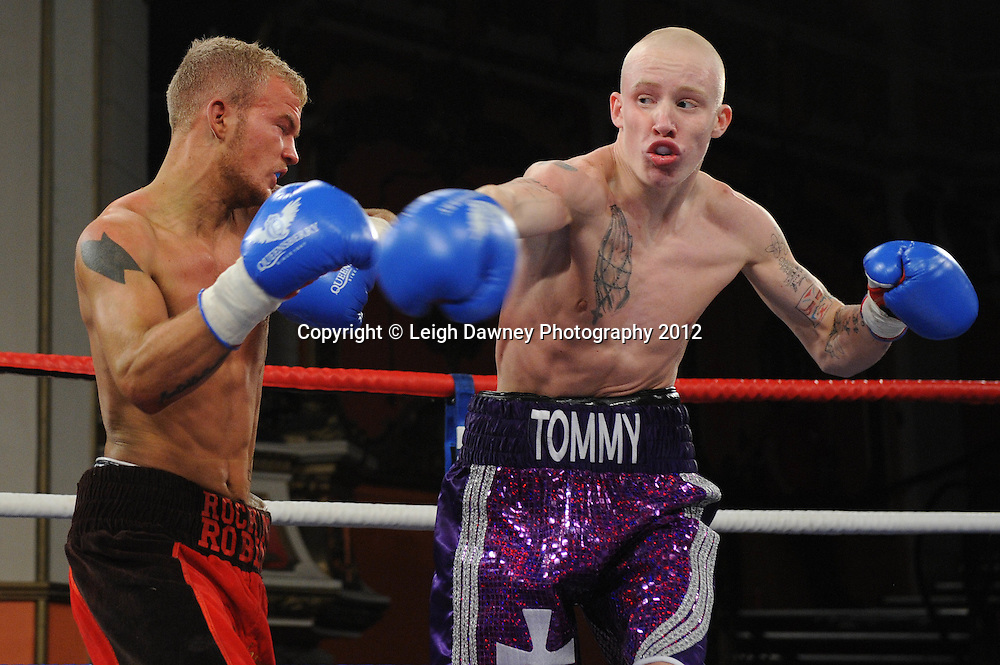 Tommy Carus (purple shorts) defeats Robin Deakin in a 4x3min Lightweight contest at Olympia, Liverpool on the 20th January 2012. Vaughan Boxing Promotions. © Leigh Dawney Photography 2012.