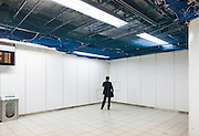 Tokyo, a Salariman take phonecall in a white space.