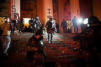 Brazil's elite military police, Shock Troops, survey the scene on the steps of the state legislature buildingRio de Janeiro, Brazil, Monday, June 17, 2013. Protests in Sao Paulo, Rio de Janeiro and other major Brazilian cities began with a 20-cent hike in public transport fares, have clearly moved beyond that issue to widespread frustration in Brazil about a heavy tax burden, politicians widely viewed as corrupt and woeful public education, health and transport systems and come as the nation hosts the Confederations Cup soccer tournament and prepares for next month's papal visit. <br />