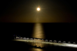 © Licensed to London News Pictures. 09/01/2012..Saltburn, England. ..A spectacular moonrise is seen over the old Victorian pier at Saltburn by the Sea in Cleveland...Photo credit : Ian Forsyth/LNP