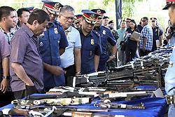 September 23, 2016 - Santos City, Phillipines - Philippine President Rodrigo Duterte inspects seized firearms on display at the Police Regional Office-12 during his visit September 23, 2016 in Santos City, Philippines. (Credit Image: © Simeon Celi/Planet Pix via ZUMA Wire)