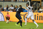 San Jose Earthquakes forward Tommy Thompson (22) and Philadelphia Union midfielder Jamiro Monteiro (35) fight for a loose ball during an MLS soccer match won by Philadelphia 2-1, Wednesday, Sept. 25, 2019, in San Jose, Calif. (Peter Klein/Image of Sport)