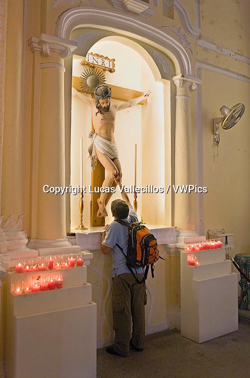China.Macao: Man praying. St Dominic´s Church. In St Dominic´s square,Macau,China