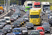 Traffic congestion cars and trucks stuck at a standstill on M25 motorway, towards London, United Kingdom