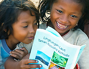 Girls read a RARE conservation booklet, Papagaran island, Komodo National Park
