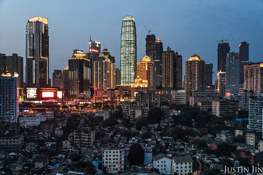 An overview of Chongqing city, one of the fastest-growing and biggest cities on earth, with a population of 29 million. <br /> <br /> The slum area under the high-rises was marked for demolition. By 2016, the area has already been entirely rebuilt. <br /> <br /> Situated in southwestern China, away from the coast, it is the engine of China's inland economic development. <br /> <br /> China is pushing ahead with a dramatic, history-making plan to move 100 million rural residents into towns and cities over the next six years &mdash; but without a clear idea of how to pay for the gargantuan undertaking or whether the farmers involved want to move.<br />