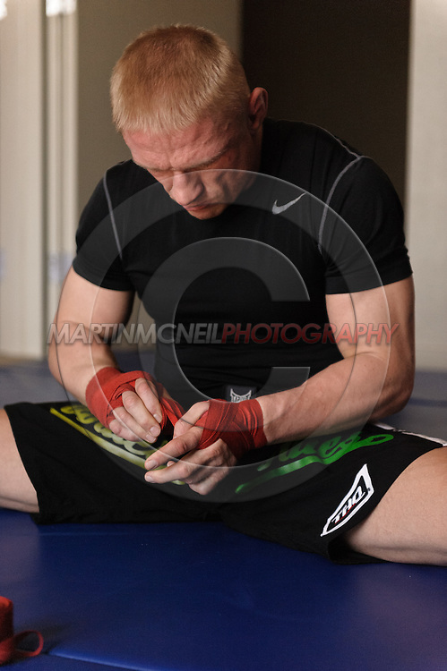 SYDNEY, AUSTRALIA, FEBRUARY 24, 2011: UFC lightweight division fighter Dennis Siver finishes applying protective hand-wraps before a training session with coach Nico Sulenta (not pictured) ahead of his fight with George Sotiropoulos at UFC 127.