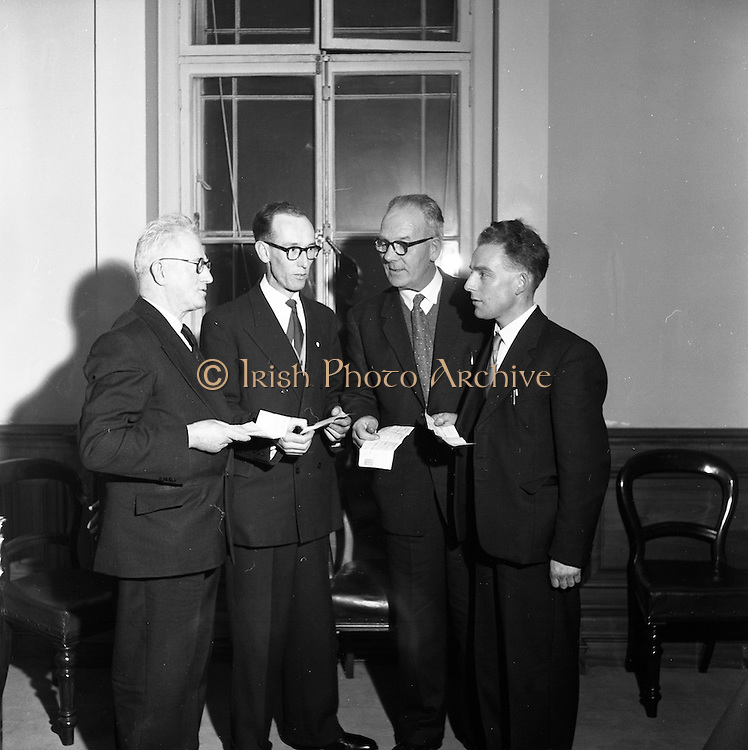 12/12/1960<br /> 12/12/1960<br /> 12 December 1960<br /> Cash bonuses for C.I.E. Traffic staff at Kingsbridge Station (Heuston Station) Dublin. The chairman of C.I.E., Dr. C.S. Andrews, presented cheques to 18 members of the Traffic Staff as a reward for their efforts in securing new business for the Board. Dr. Andrews said it was a great pleasure to recognise individual effort and added that he would like to see some scheme acceptable to the Trade Unions devised that would enable the earnings of individual workers to be related to their efforts. Picture shows (l-r): Bus Inspectors T.Doyle (Ballina); G. Cowley (Westport); W. O'Donnell (Ballina) and Station-master J. Cuffe (Swinford).