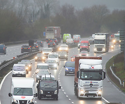 ©Licensed to London News Pictures 10/12/2019. <br /> Swanley,UK. Wet and windy driving conditions for motorists on the M25 this afternoon near Swanley, Kent.  Photo credit: Grant Falvey/LNP