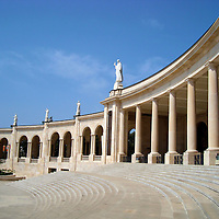 Colonnade at the Sanctuary of Our Lady of Fátima in Portugal <br /> During every anniversary of the original 1917 appearance of the Our Lady of the Rosary, particularly on May and October 13, up to a million people make a pilgrimage to Fatima, Portugal.  Many of them stand along this colonnade and plaza during the religious ceremonies.