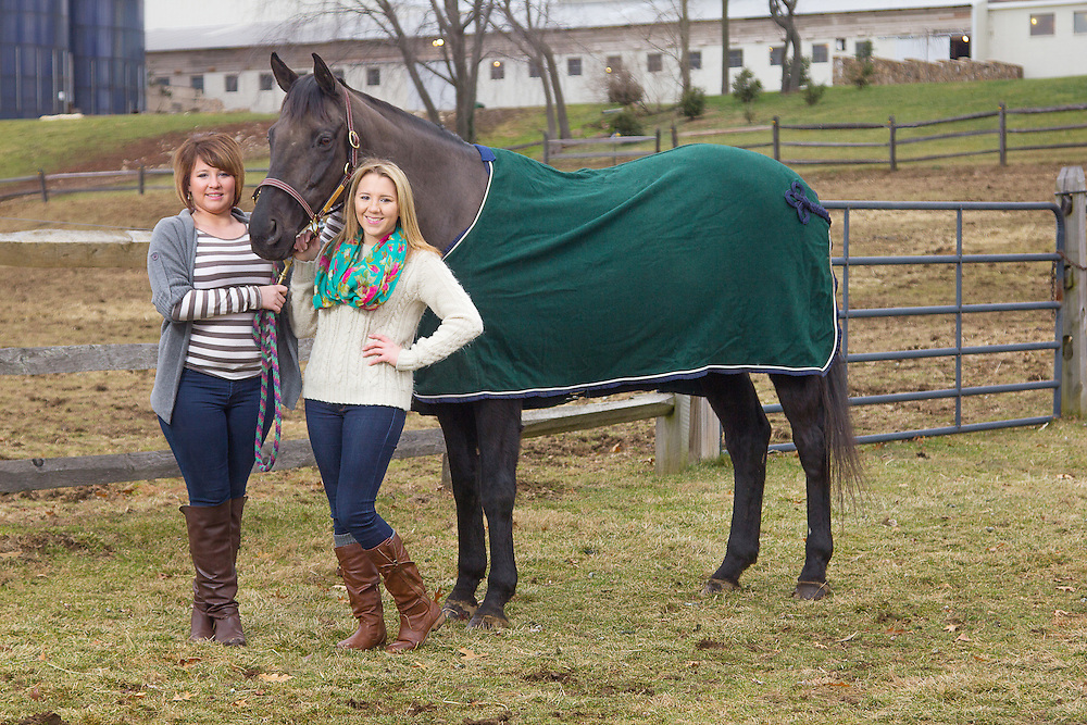 Kaitlin and Kelsey Groening pose with their horse Simon