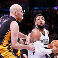 28 February 2014: Sacramento Kings power forward Derrick Williams (13) drives past Los Angeles Lakers center Chris Kaman (9) during the Los Angeles Lakers 126-122 victory over the Sacramento Kings at the Staples Center, Los Angeles, California, USA.