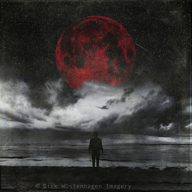 Man standing on an alien beach with a red moon looming in the sky - image manipulation with my own photos