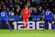 Liverpool forward Ben Woodburn (58) with Leicester City midfielder Demarai Gray (22) and Leicester City defender Danny Simpson (17) closing in during the Premier League match between Leicester City and Liverpool at the King Power Stadium, Leicester, England on 27 February 2017. Photo by Jon Hobley.