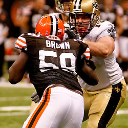 Oct 24, 2010; New Orleans, LA, USA; New Orleans Saints offensive tackle Jonathan Stinchcomb (78) blocks against Cleveland Browns linebacker Marcus Benard (58) during the second half at the Louisiana Superdome. The Browns defeated the Saints 30-17.  Mandatory Credit: Derick E. Hingle
