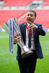 Peterborough Manager Darren Ferguson (SCO) celebrates with the trophy after a 3-1 win in the match - Photo mandatory by-line: Rogan Thomson/JMP - 07966 386802 - 30/03/2014 - SPORT - FOOTBALL - Wembley Stadium, London - Chesterfield FC v Peterborough United - Johnstone's Paint Trophy Final.