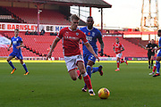 Birmingham City midfielder Emilio Nsue (2) and Barnsley FC midfielder Brad Potts (20) during the EFL Sky Bet Championship match between Barnsley and Birmingham City at Oakwell, Barnsley, England on 4 November 2017. Photo by Ian Lyall.
