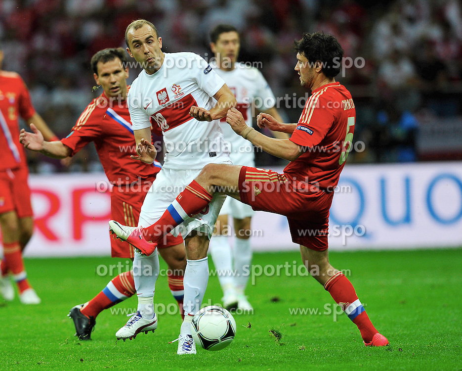 Warsaw 12/06/2012.POLAND, WARSAW .Yuri Zirkhov of Russia fights for the ball with Adrian Mierzejewski of Poland during the Euro 2012 football championships match Poland vs. Russia, on June 12, 2012 at the National Stadium in Warsaw. .Photo by: Piotr Hawalej / WROFOTO
