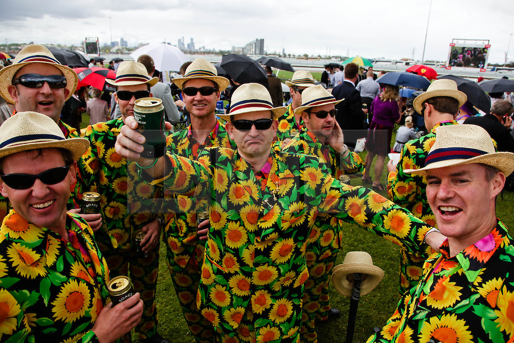 (c) under License to London News Pictures 02/11/2010. Racegoers at the 2010 Melbourne cup in matching floral suits, in the general public section of Flemington race course