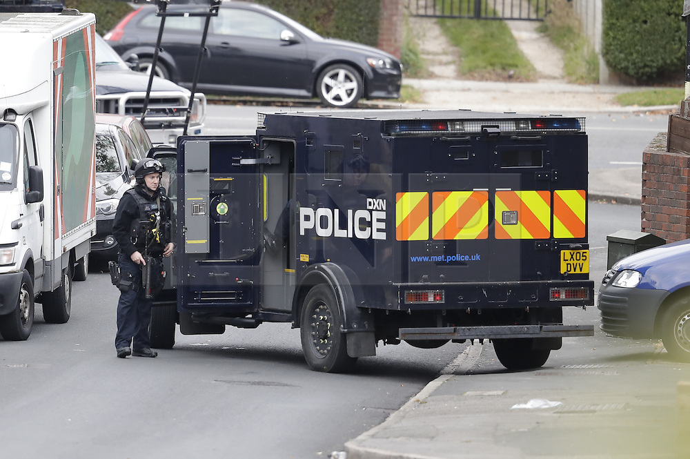 © Licensed to London News Pictures. 22/10/2016. London, UK. Armed police surround a house in Lancaster Road in Northolt. Police are surrounding an address here after a report of concerns for the occupant and hazardous items inside the property. Police believe a man is still inside the house. Photo credit: Peter Macdiarmid/LNP