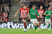 Southampton midfielder Pierre-Emile Hojbjerg (23) battles with Brighton and Hove Albion midfielder Davy Propper (24) during the Premier League match between Southampton and Brighton and Hove Albion at the St Mary's Stadium, Southampton, England on 17 September 2018.