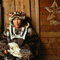 Russia, Magadan District, Tamara Khutkovav wears traditional Koryuk reindeer dress in village on Taygonos Peninsula