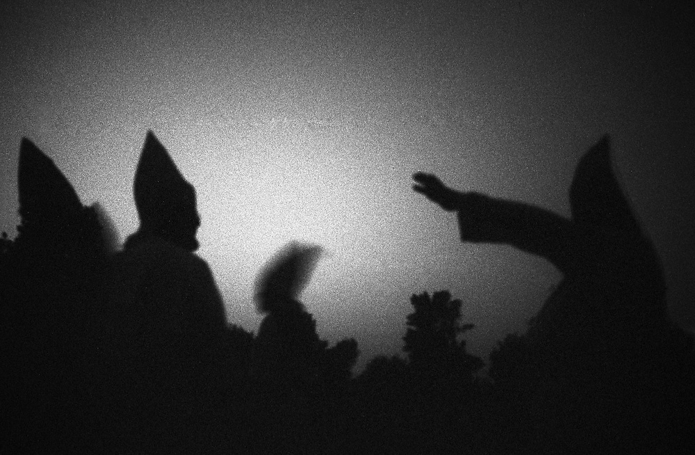 Members of the Ku Klux Klan appear in silhouette in Osceola, Indiana. (Photo by William B. Plowman)