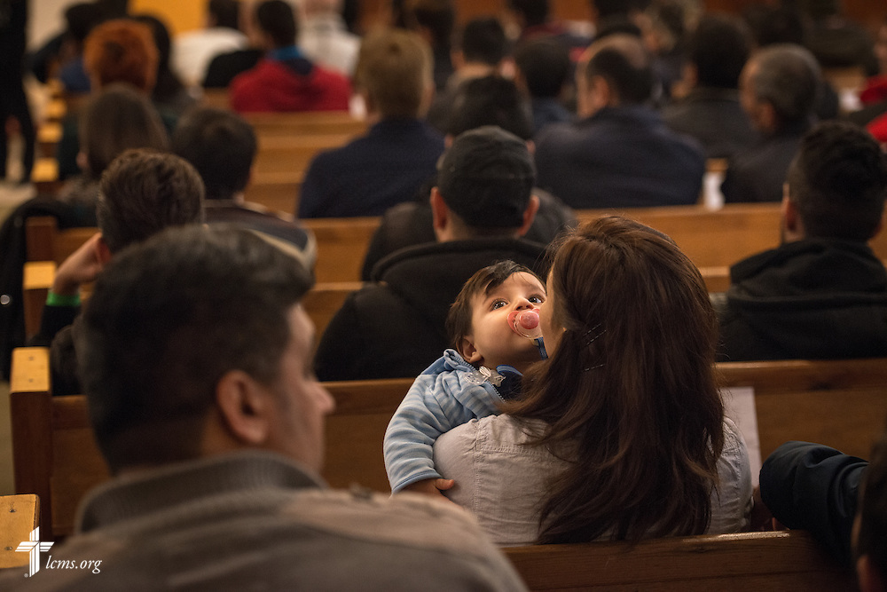 A mother holds her child during Bible study on Saturday, Nov. 14, 2015, at the Dreieinigkeits-Gemeinde, a SELK Lutheran church in Berlin-Steglitz, Germany.  LCMS Communications/Erik M. Lunsford