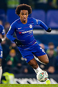 Chelsea midfielder Willian (22) on the ball during the EFL Cup semi final second leg match between Chelsea and Tottenham Hotspur at Stamford Bridge, London, England on 24 January 2019.