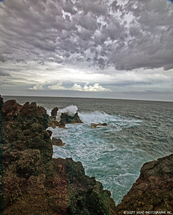 Cloud formations during storm over Molokai, with crashing waves, Kapalua, Maui, Hawaii
