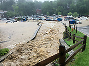 Ellicott City, Maryland - May 27, 2018: Flood waters envelop a parking lot in Historic Ellicott City, pulling several cars into the river.<br /> <br /> Historic Ellicott City Maryland was destroyed by floodwaters Sunday May 27, 2018 -- the same day of Kristen Rigney and Craig Cymbor's wedding at Main Street Ballroom in Ellicott City. Their wedding venue flooded minutes before their ceremony was scheduled and the entire wedding party fled to La Palapa, the Mexican food restaurant upstairs, where Craig and Kristen said their vows. Instead of eating, drinking and dancing, the wedding party, watched cars get swept away. <br /> CREDIT: Matt Roth