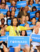 "LAURA FONG |  First Lady Michelle Obama greets a crowd of 2,000 at Cuyahoga Community College in Cleveland. ""I don't just love my husband because he's cute; I mean, he's fine right? I fell in love with Barack because of his character."""