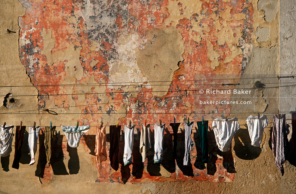 Personal underwaer clothing hangs from string against a wall of peeling plaster, on 21st March 1994, in Lisbon, Portugal. (Photo by Richard Baker / In Pictures via Getty Images)