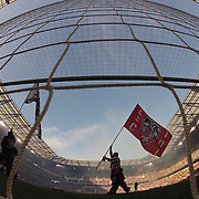 A flag bearer walks past the goalmouth during pre game presentations before the New York Red Bulls Vs New England Revolution, MLS Eastern Conference Final, first leg at Red Bull Arena, Harrison, New Jersey. USA. 23rd November 2014. Photo Tim Clayton
