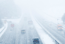 Heavy Snowfall in West Lothian, Wednesday, 4th April 2018<br /> <br /> More heavy snow fell in West Lothian this afternoon causing traffic problems for drivers on the M8 Edinburgh to Glasgow motorway.<br /> <br /> Alex Todd   EEm