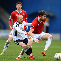 TELFORD COPYRIGHT MIKE SHERIDAN 9/3/2019 - Adam Dawson of AFC Telford (on loan from Macclesfield Town FC) battles for the ball with Stephen O'Halloran during the National League North fixture between AFC Telford United and FC United of Manchester (FCUM) at the New Bucks Head Stadium