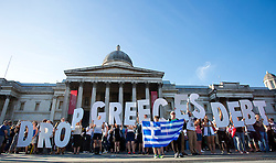 © Licensed to London News Pictures. 29/06/2015. London, UK. Activists campaign against austerity in a demonstration organized by Solidarity with Greece at Trafalgar Square, central London, as they call for the Greek debt to be wiped. Photo credit: LNP