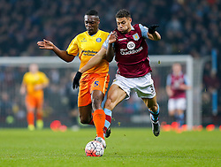 Anthony Stewart of Wycombe Wanderers and Rudy Gestede of Aston Villa compete for the ball - Mandatory byline: Rogan Thomson/JMP - 19/01/2016 - FOOTBALL - Villa Park Stadium - Birmingham, England - Aston Villa v Wycombe Wanderers - FA Cup Third Round Replay.