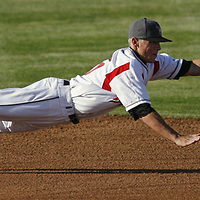 Salem-Keizer shortstop John Eshleman lays out to grab a grounder up the middle in the top of the first inning during a Northwest League game against Boise at Volcanoes Stadium on Wednesday, June 24, 2009.