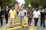 September 3, 2012- Brooklyn, New York:  (L-R)NYC Schools Chancellor Derek Walcott, NYC Mayor Michael Bloomberg, and Richard Green, Crown Heights Youth Collective attend the 45th Annual West Indian Day Labor Day Celebration held on September 3, 2012 along Brooklyn's famed Eastern Parkway. It's one of New York City's most popular parades, a cultural festival that celebrates West Indian history, culture, music and food. Attended by as many as two million people. (Photo by Terrence Jennings)