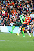 Bayo Akinfenwa of AFC Wimbledon battles Olly Lee during the Sky Bet League 2 match between Luton Town and AFC Wimbledon at Kenilworth Road, Luton, England on 26 September 2015. Photo by Stuart Butcher.