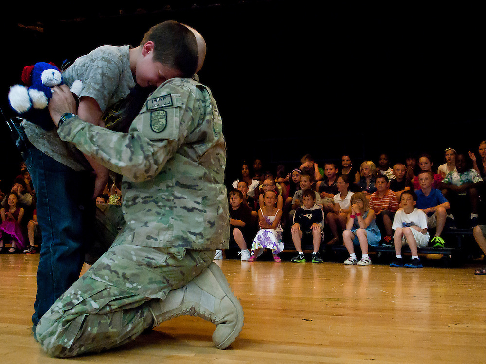 Christopher Bratic, 10, rest his head on the shoulder of his father United States Army Staff Sergeant Luis Bratic after being surprised by his father during a school assembly at Lillian G. Mason Elementary School in Grand Blanc Township, Mich., Thursday June 7, 2012. Christopher did not expect his father to come home from an 11-month tour in Afghanistan until later in the month when his father walked out on stage as Christopher was reciting the Pledge of Allegiance at the beginning of the assembly.