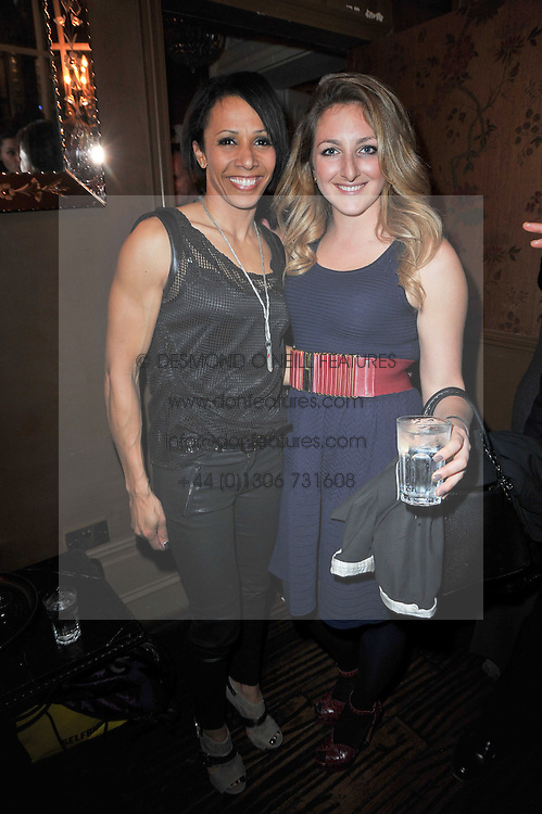 Left to right, DAME KELLY HOLMES and NATASHA CORRETT at a party to celebrate the publication of her new book - Kelly Hoppen: Ideas, held at Beach Blanket Babylon, 45 Ledbury Road, London W11 on 4th April 2011.