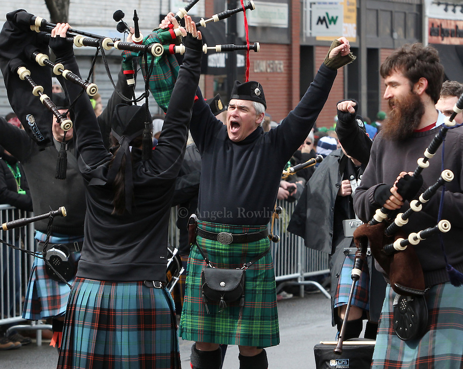 (Boston, MA - 3/15/15) Members of the Catamount Pipe Band cheer during the St. Patrick's Day Parade in South Boston, Sunday, March 15, 2015. Staff photo by Angela Rowlings.